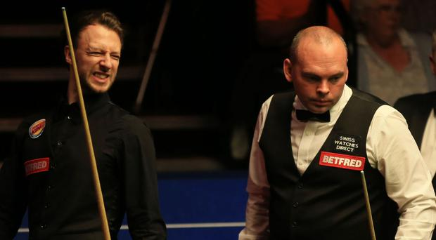 Stuart Bingham, right, accounted for Judd Trump at Venue Cymru