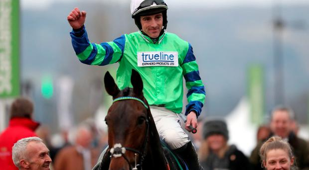 Winner alright: Ulster jockey Brian Hughes, who rides Somersby in today's feature, celebrates victory on Ballyalton in yesterday's Close Brothers Novices Handicap Chase