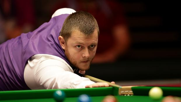 Northern Ireland's Mark Allen beat Mitchell Mann 10-3 to reach the second round in Sheffield