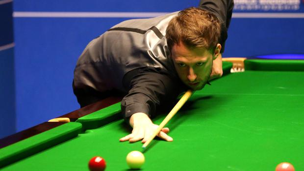 Judd Trump survived a tough battle against Liang Wenbo at the Crucible