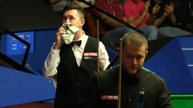 Kyren Wilson, left, shows his emotion after beating Mark Allen at the Crucible