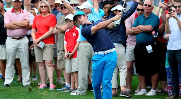 In the swing: Rory McIlroy hits a shot ahead of the 2016 Wells Fargo Championship at Quail Hollow Club