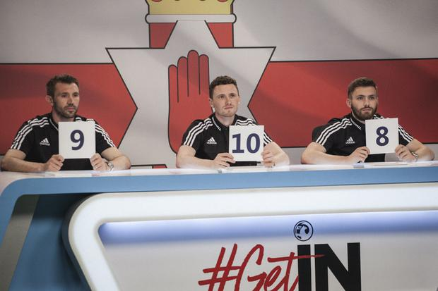 Corry Evans, Stuart Dallas and Gareth McAuley cast their votes