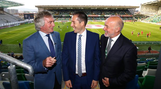 Walk in the Park: Northern Ireland greats Pat Jennings and Sammy McIlroy greet new Sports Minister Paul Givan at Windsor Park before Northern Ireland's 3-0 victory over Belarus