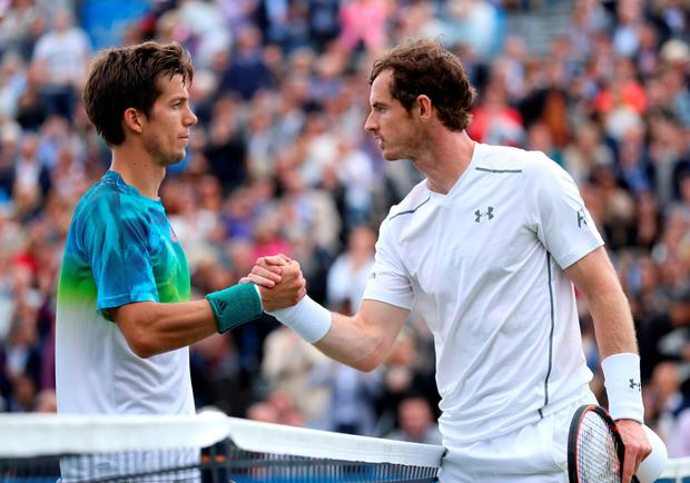 Andy Murray shakes hands with Aljaz Bedene after hiss second round victory