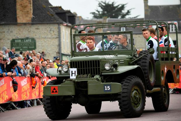 Big guns: Mark Cavendish, with his Dimension Data team aboard a World War II US army vehicle during a Tour de France parade in Normandy