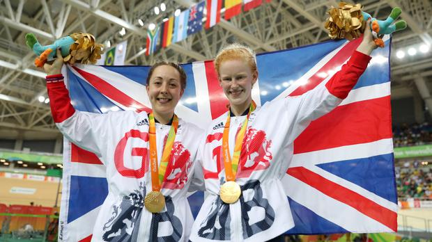 Sophie Thornhill, right, and her tandem pilot Helen Scott won gold on Friday