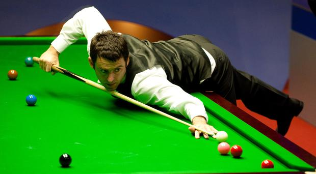 Ronnie O'Sullivan wasted little time progressing to round two in Belfast