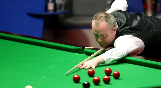 John Higgins, the world number three, battled into the second round of the Indian Open