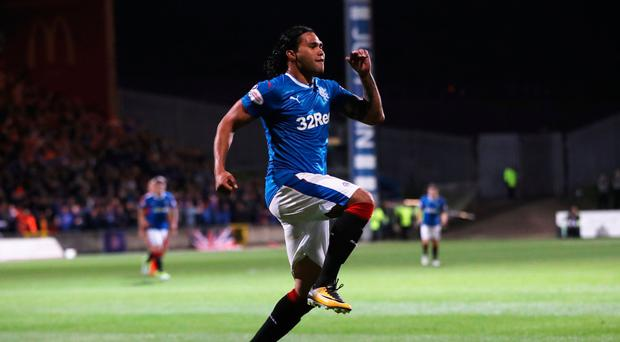 Killer touch: Carlos Pena celebrates the opening goal for Rangers