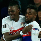 Match winner: Bertrand Traore (left) got Lyon's second goal
