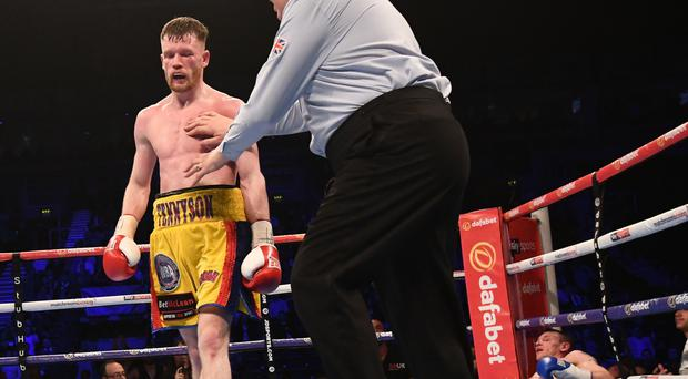Down and out: James Tennyson stops Darren Traynor