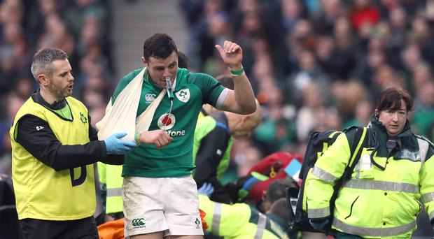 Robbie Henshaw leaves the pitch with his arm in a sling after scoring two tries