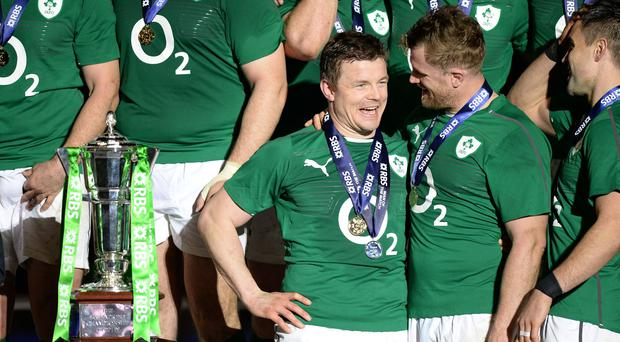 Brian O'Driscoll, left, and Jamie Heaslip played together with Ireland and Leinster (Andrew Matthews/PA)