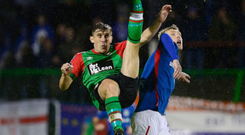 Front foot: Glentoran's Marcus Kane makes an acrobatic intervention under pressure from Kirk Millar