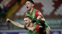 Riding high: James Ferrin and Joe Crowe enjoy Glentoran's win