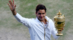 Grand feeling: Roger Federer sets a new Grand Slam record haul at Wimbledon in 2009