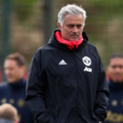 Close watch: Jose Mourinho oversees United training yesterday but Paul Pogba played no part