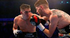 Big impact: Michael Conlan (left) lands a blow on Yorkshire opponent Jason Cunningham at the Manchester Arena