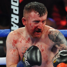 Bad break: Paddy Barnes shows the effects of getting caught by Oscar Mojica in New York