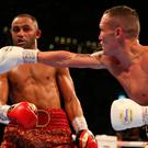 Front foot: Josh Warrington lands a right on Kid Galahad