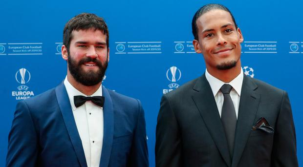Big names: Liverpool's Brazilian goalkeeper Alisson Becker (left) and Dutch defender Virgil van Dijk at yesterday's Champions League draw in Monaco