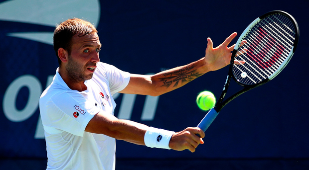 Big win: Dan Evans on way to victory over Lucas Pouille