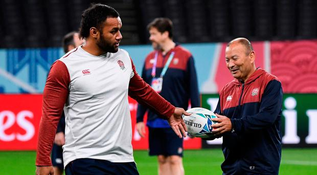 Safe hands: Billy Vunipola hands the ball to Eddie Jones during England's Captain's Run in Japan