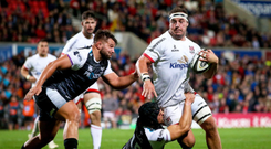 On the run: Ulster's Rob Herring gets away from Tom Botha and Dan Evans of the Ospreys