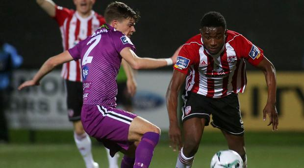 Familiar foes: Derry's Junior Ogedi-Uzokwe takes on Dundalk ace Sean Gannon in the EA Sports League Cup fin