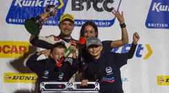 Happy family: Colin Turkington celebrates title glory with wife Louise and sons Adam and Louis