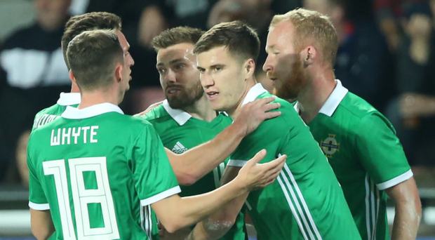 First blood: Paddy McNair is mobbed after opening the scoring against the Czech Republic