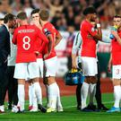 Sorry sight: England players during a break over racist chanting