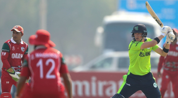 Big hit: Gareth Delany en route to his 89 not out against Oman