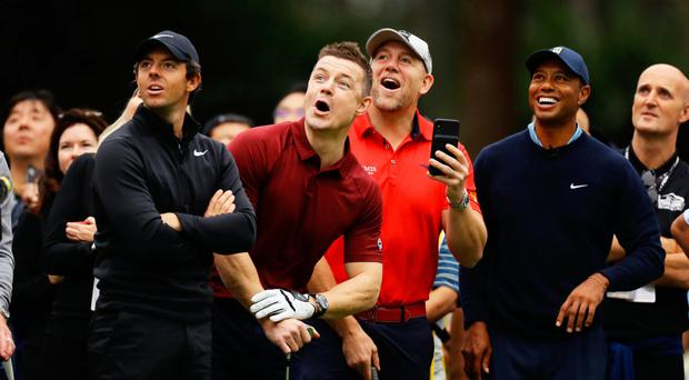 Worlds collide: Rory McIlroy, Brian O'Driscoll, Mike Tindall and Tiger Woods watch a tee-shot hit by Bryan Habana in Japan