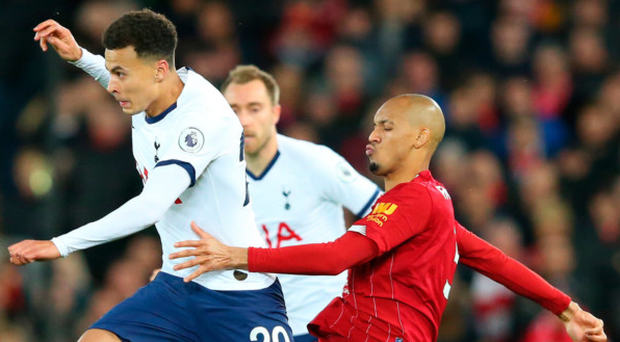 Stuck in: Fabinho steals possession from Dele Alli