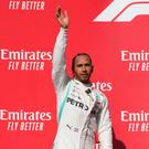 Title delight: Lewis Hamilton salutes the crowd after sealing his sixth world crown in Texas