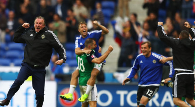 High point: Michael O'Neill celebrates NI's second goal against Ukraine at Euro 2016