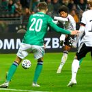 Hard to take: Serge Gnabry of Germany scores his team's third goal against Northern Ireland