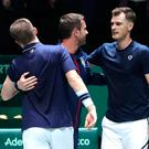 Nice one: Jamie Murray celebrates with GB captain Leon Smith and (left) Neal Skupski