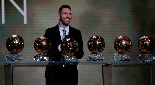Six appeal: Lionel Messi shows off his six Ballon d'Or titles
