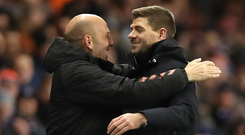 Staying put: Steven Gerrard and assistant Gary McAllister were delighted to sign new Rangers deals