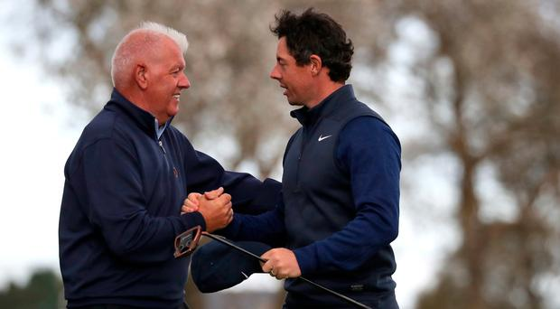 Showmen: Rory McIlroy and his dad Gerry kept the crowds entertained at Carnoustie