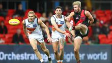 Big change: Conor McKenna in action for the Essendon Bombers, but he admits he struggled to adapt and yearned for home