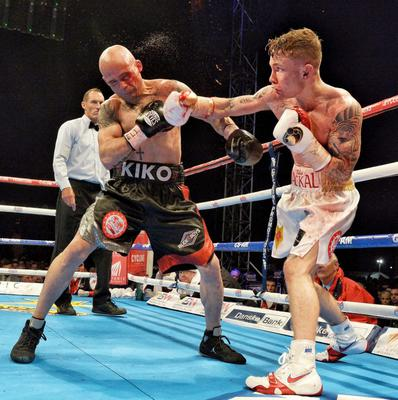 Packing a punch: Carl Frampton lands a blow against Kiko Martinez en route to clinching the IBF World super-bantamweight title at the Titanic slipway last September