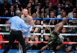 All over: the referee steps in to stop the bout in the 10th round