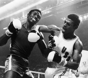 Spinks also had success at the Olympics, where he is shown letting a right fly at the face of Cuba's Sixto Soria in Montreal (AP)