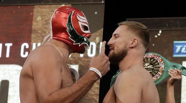 Tyson Fury, left, and Otto Wallin go head to head at the weigh-in ahead of their bout (Isaac Brekken/AP).