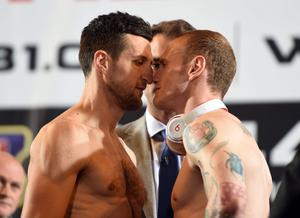 The pair face off after the weigh-in (Adam Davy/PA)