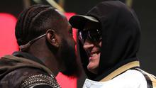 Deontay Wilder and Tyson Fury confront each other on stage at the MGM Grand (Bradley Collyer/PA)